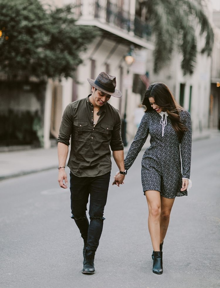 Stylish couple walking through the streets of New Orleans French Quarter