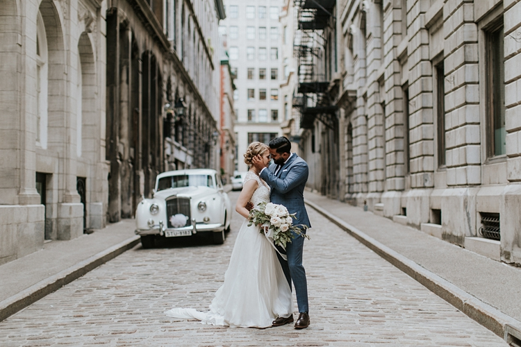 Couple kiss in the middle of the road in Old Montreal